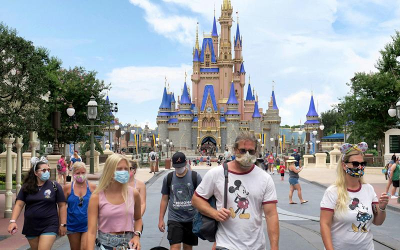 Tourists at Disney World when it reopened yeterday - Joe Burbank/Orlando Sentinel via AP