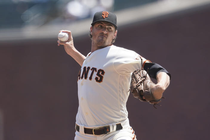 San Francisco Giants' Kevin Gausman pitches against the San Diego Padres during the first inning of a baseball game in San Francisco, Saturday, May 8, 2021. (AP Photo/Jeff Chiu)