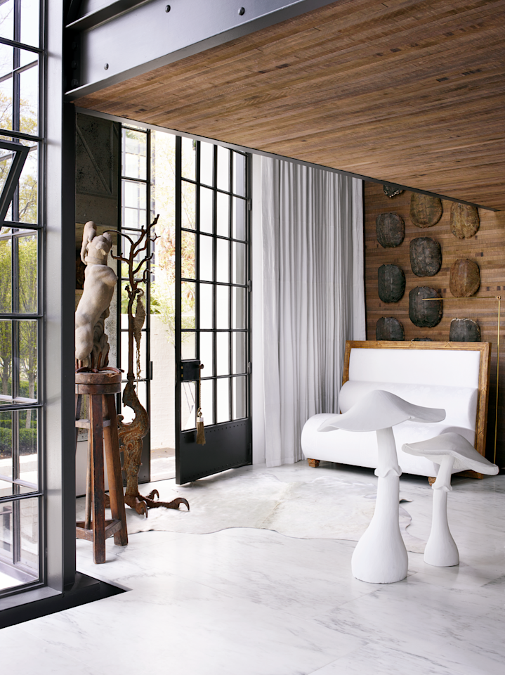 "<p>Quirky mushroom sculptures greet visitors at the entry way of architect <a href=""https://www.mcalpinehouse.com/"">Bobby McAlpine's</a> Atlanta residence. Light floods through the massive glass-paned doors and reflects off Vermont marble flooring from <a href=""https://www.marmistone.com/"">Marmi Natural Stone</a>. The cowhide rug is from <a href=""http://www.abchome.com/"">ABC Carpet & Home</a>.</p>"