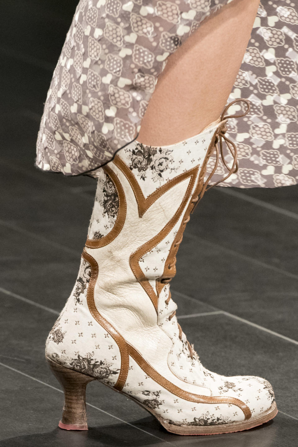 <p><i>White and brown printed leather cowboy boots from the SS18 Anna Sui collection. (Photo: ImaxTree) </i></p>