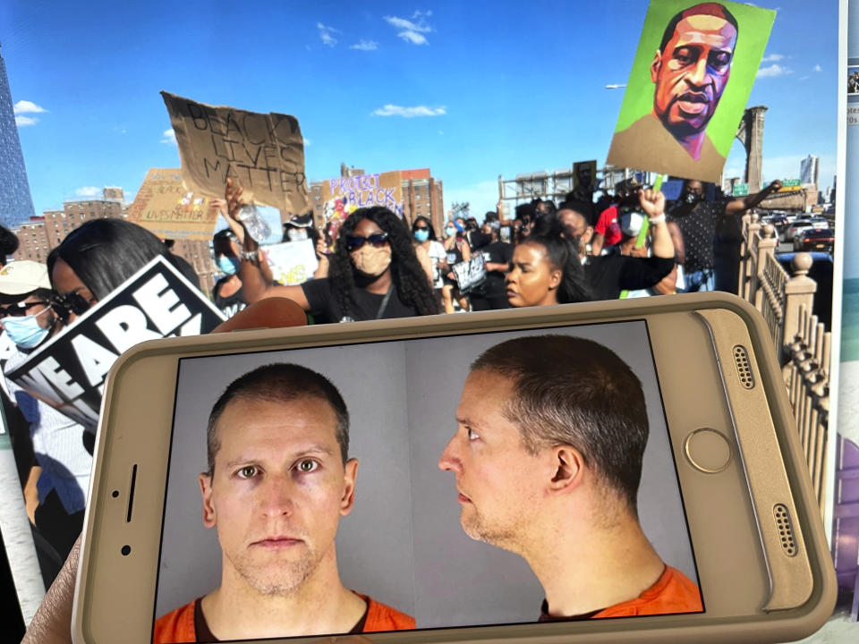 Photo by: STRF/STAR MAX/IPx 2021 3/29/21 Testimony begins in the murder trial of Derek Chauvin charged in the kling of George Floyd. STAR MAX Photo: Mug shots of Derek Chauvin photographed off an iphone 8 plus with murals and signs depicting George Floyd in the background.