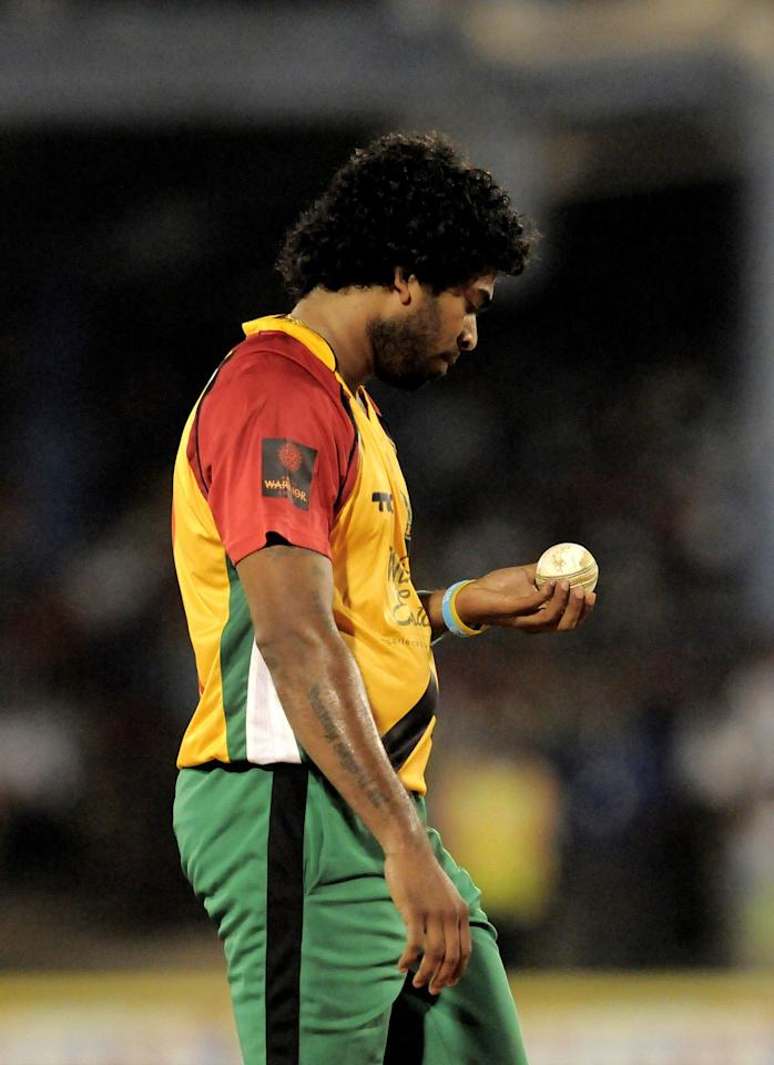 PORT OF SPAIN, TRINIDAD AND TOBAGO - AUGUST 24:  Lasith Malinga of Guyana Amazon Warriors ready to bowl during the Final of the Caribbean Premier League between Guyana Amazon Warriors v Jamaica Tallawahs at Queens Park Oval on August 24, 2013 in Port of Spain, Trinidad and Tobago. (Photo by Randy Brooks/Getty Images Latin America for CPL)