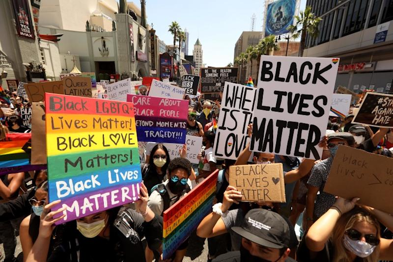 HOLLYWOOD, CA - JUNE 14, 2020 - - Thousands participate in the All Black Lives Matter solidarity march to mark LGBTQ Pride Month along Hollywood Blvd. in Hollywood on June 14, 2020. The march also honored Tony McDade, a transgender man killed by Tallahassee Police Department officers on May 27. The march is in solidarity with the Black Lives Matter movement and highlight the contributions of people of color who were instrumental in organizing the LGBT movement, such as Marsha P. Johnson and Sylvia Rivera. The procession started on Hollywood Boulevard at Highland Avenue in Hollywood. (Genaro Molina / Los Angeles Times)