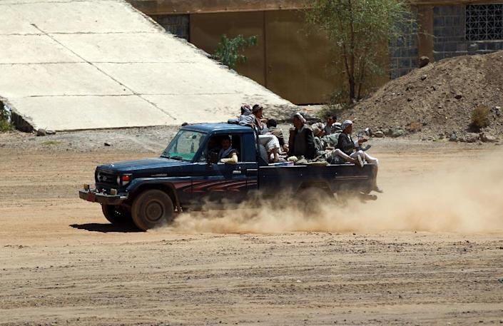 Yemeni Shiite rebels drive a pickup truck at an army base which they captured on September 22, 2014 in the capital, Sanaa (AFP Photo/Mohammed Huwais)