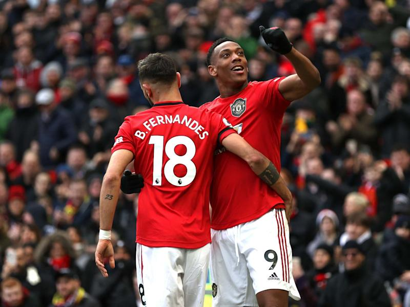 Anthony Martial celebrates after adding United's second of the game: Getty Images