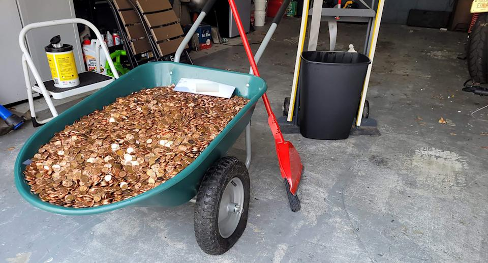A wheelbarrow full of pennies
