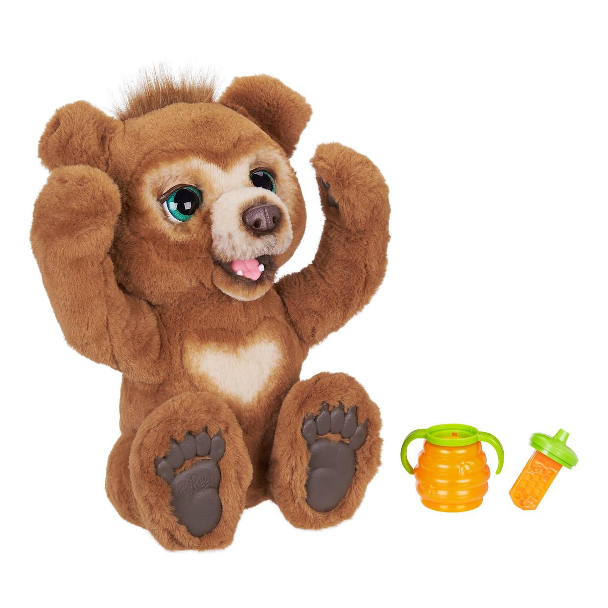 "This delightfully curious, expressive bear cub loves to play with you during the day. In nighttime mode, he makes sleepy sounds and plays soft music. He&rsquo;s a day-to-night best friend! <strong><a href=""https://fave.co/2PD1IKM"" rel=""nofollow noopener"" target=""_blank"" data-ylk=""slk:Find it for $97 at Walmart"" class=""link rapid-noclick-resp"">Find it for $97 at Walmart</a>.</strong>"