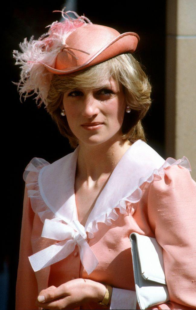 <p>Diana wore this peach Belville Sassoon dress with a ruffled and wide drape collar and a John Boyd hat while on a visit to Australia in 1983.</p>
