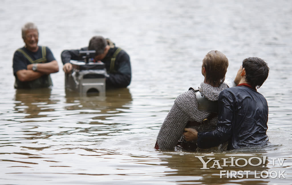 The Merlin actors often found themselves in water - even while wearing heavy chainmail, as Bradley James is doing here while shooting a scene with Colin Morgan.