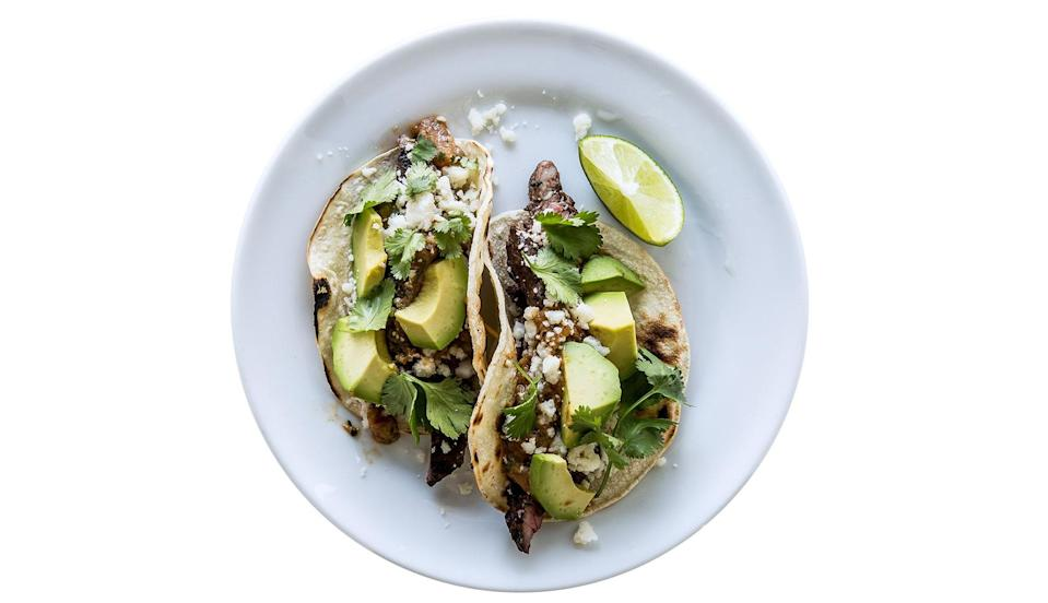 """Any fairly thin cut of beef will work with this marinade; try flank or New York strip. <a href=""""https://www.bonappetit.com/recipe/tecate-skirt-steak-tacos?mbid=synd_yahoo_rss"""" rel=""""nofollow noopener"""" target=""""_blank"""" data-ylk=""""slk:See recipe."""" class=""""link rapid-noclick-resp"""">See recipe.</a>"""