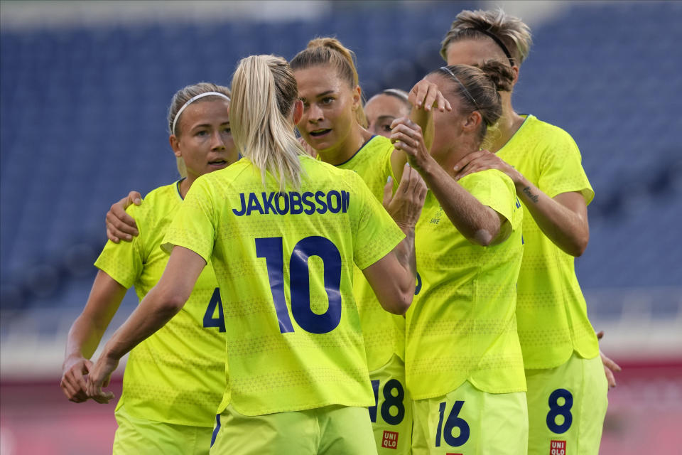 Sweden's players gather during a women's soccer match against Australia at the 2020 Summer Olympics, Saturday, July 24, 2021, in Saitama, Japan. (AP Photo/Martin Mejia)