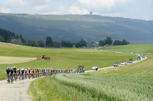 The pack of cycles during the 6th stage, a 192.8 km race, from Bueren an der Aare to Delemont, at the 78th Tour de Suisse UCI ProTour cycling race, in Chaumont, Switzerland, Thursday, June 19, 2014. (AP Photo/Keystone,Jean-Christophe Bott)
