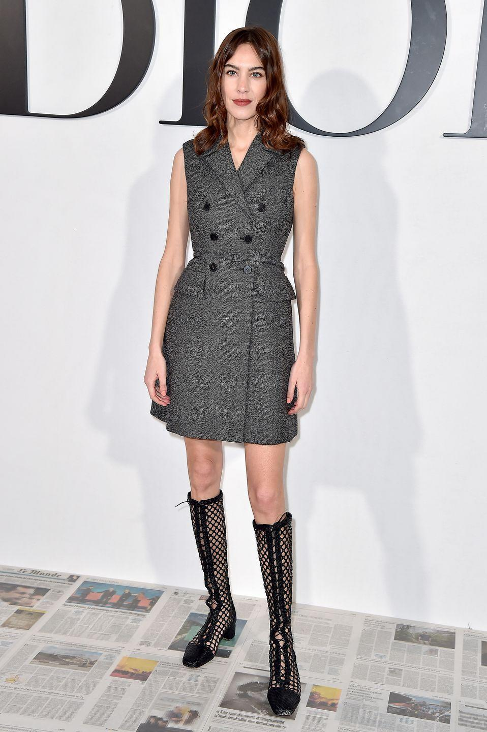 <p>Alexa Chung attended the show in lace-up boots and a tailored blazer dress. </p>