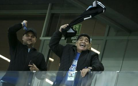 Diego Maradona twirls Messi jersey around his head - Credit: GETTY IMAGES