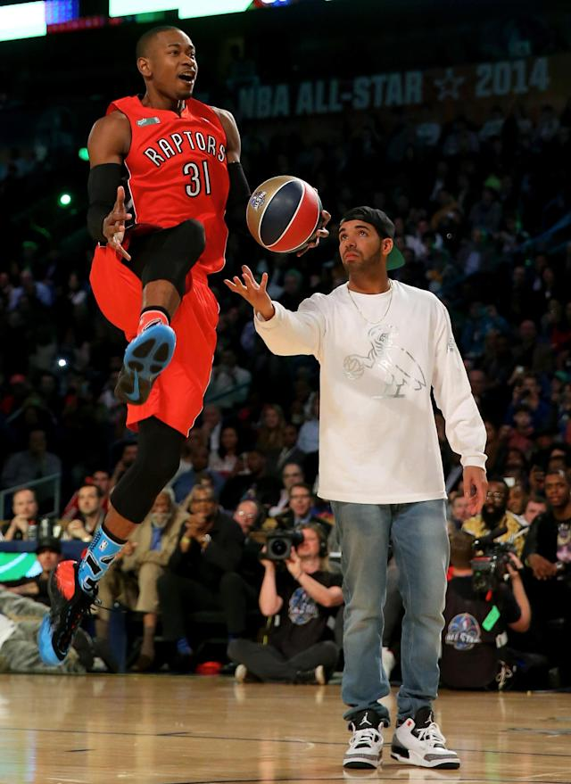 NEW ORLEANS, LA - FEBRUARY 15: Eastern Conference All-Star Terrence Ross #31 of the Toronto Raptors takes the ball from Drake during the Sprite Slam Dunk Contest 2014 as part of the 2014 NBA All-Star Weekend at the Smoothie King Center on February 15, 2014 in New Orleans, Louisiana. NOTE TO USER: User expressly acknowledges and agrees that, by downloading and or using this photograph, User is consenting to the terms and conditions of the Getty Images License Agreement. (Photo by Ronald Martinez/Getty Images)