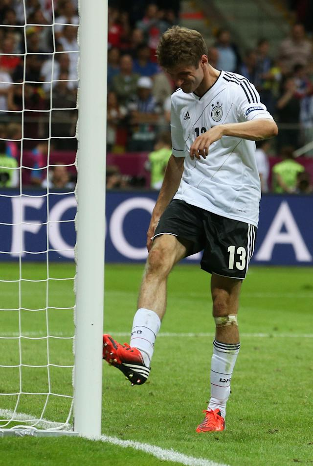 WARSAW, POLAND - JUNE 28: Thomas Muller of Germany kicks the goal post after the UEFA EURO 2012 semi final match between Germany and Italy at the National Stadium on June 28, 2012 in Warsaw, Poland. (Photo by Joern Pollex/Getty Images)