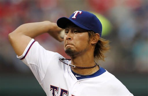 Texas Rangers' Yu Darvish (11) of Japan delivers to the Seattle Mariners in the first inning of a baseball game Monday, April 9, 2012, in Arlington, Texas. (AP Photo/Tony Gutierrez)