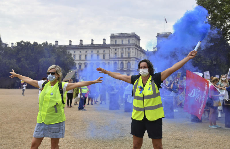 National Health Service (NHS) workers demonstrate as part of a national protest over pay, in London, Saturday Aug. 8, 2020. Nationwide protests on Saturday are calling for government to address what they claim is many years of reduced wages, and are calling for a voice in plans for public sector pay increases. (Dominic Lipinski/PA via AP)