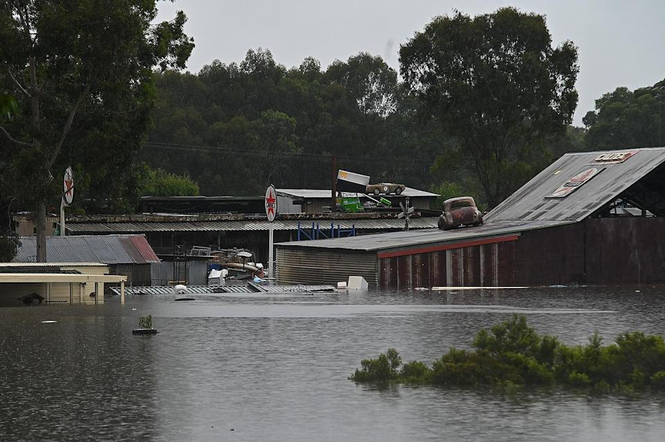 <p>Some structures float in Richmond, a town northwest of Sydney, on Monday.</p>