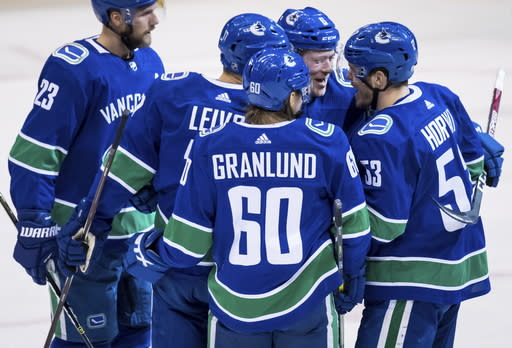 Vancouver Canucks' Alexander Edler, of Sweden; Josh Leivo; Markus Granlund, of Finland; Brock Boese; and Bo Horvat celebrate Boeser's goal against the New York Rangers during the second period of an NHL hockey game Wednesday, March 13, 2019, in Vancouver, British Columbia. (Darryl Dyck/The Canadian Press via AP)