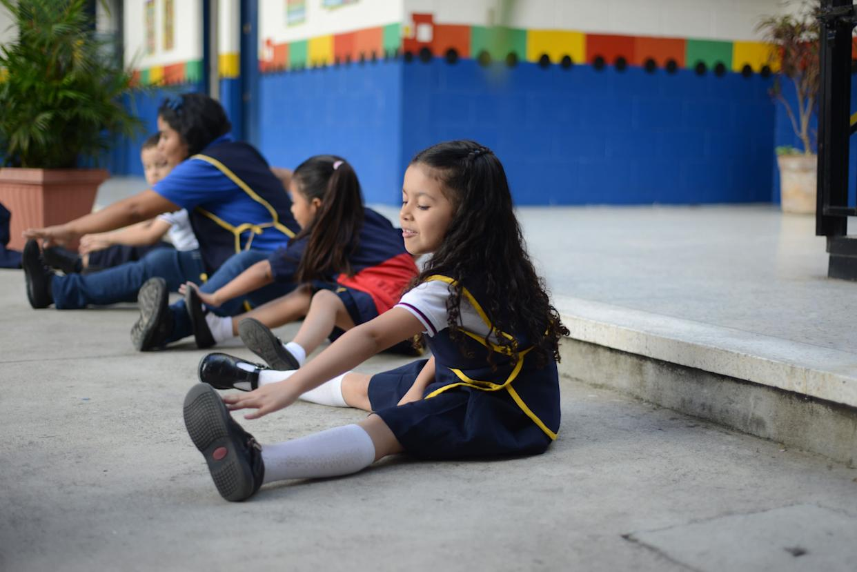 Valentina Rodas stretches at school in Guatemala City on July 8, 2013.