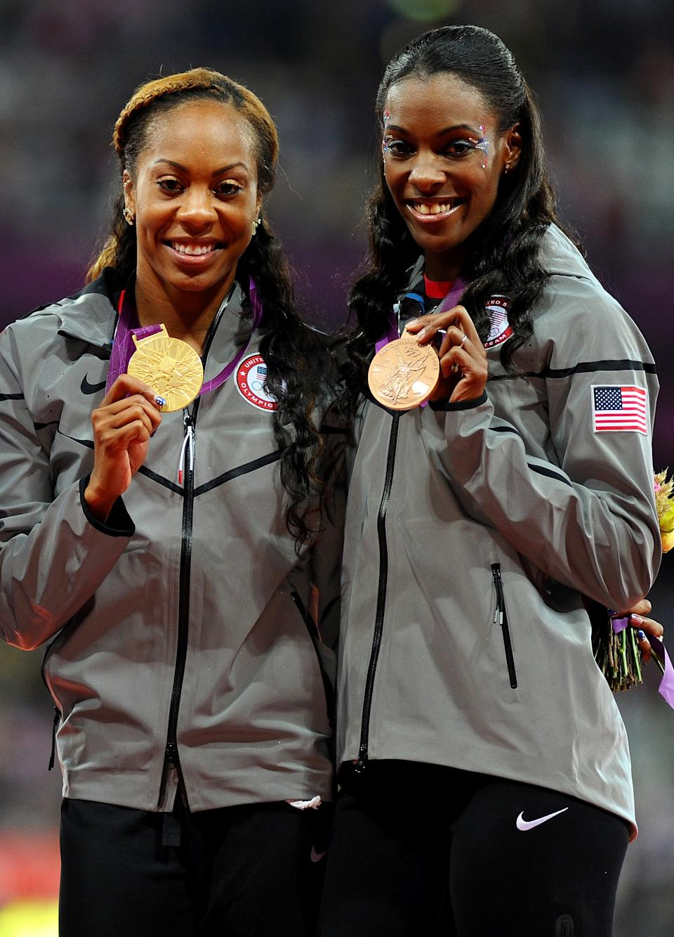 """(L-R) Gold medalist <a href=""""http://sports.yahoo.com/olympics/track-field/sanya-richards-ross-1130538/"""" data-ylk=""""slk:Sanya Richards-Ross"""" class=""""link rapid-noclick-resp"""">Sanya Richards-Ross</a> and bronze medalist <a href=""""http://sports.yahoo.com/olympics/track-field/deedee-trotter-1131834/"""" data-ylk=""""slk:DeeDee Trotter"""" class=""""link rapid-noclick-resp"""">DeeDee Trotter</a> of the United States pose on the podium during the medal ceremony for the Women's 400m Final on Day 9 of the London 2012 Olympic Games at the Olympic Stadium on August 5, 2012 in London, England. (Photo by Mike Hewitt/Getty Images)"""