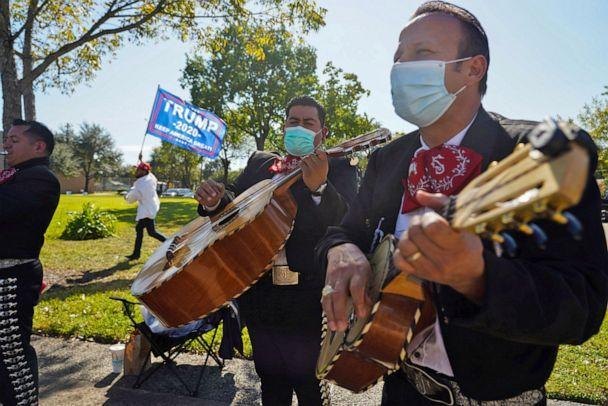PHOTO: A Mariachi band plays outside of a polling site on Election Day in Houston, Nov. 3, 2020.  (Go Nakamura/Reuters, FILE)