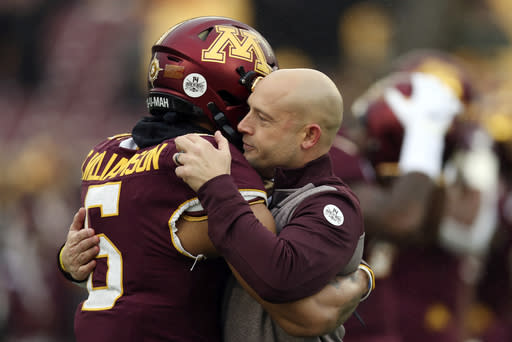 FILE - In this Saturday, Nov. 30, 2019, file photo, Minnesota head coach P.J. Fleck hugs defensive back Chris Williamson (6) during an NCAA college football game against Wisconsin, in Minneapolis. Fleck has never lacked for clever ways to connect and motivate his players. (AP Photo/Stacy Bengs, File)
