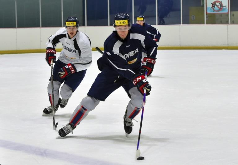 South Korea's ice hockey team player, US-born Mike Testwuide (C), skates during a practice session at a rink in Goyang, north-west of Seoul