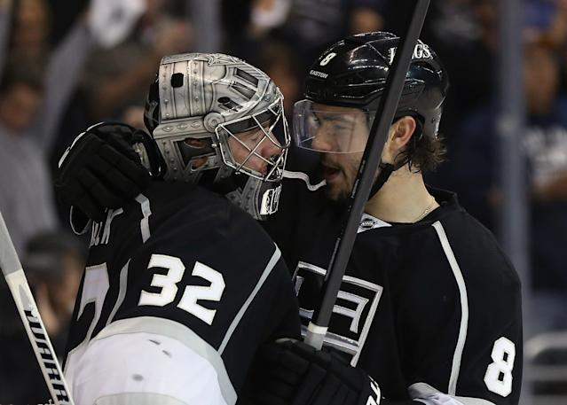 LOS ANGELES, CA - MAY 14: Goaltender Jonathan Quick #32 and Drew Doughty #8 of the Los Angeles Kings celebrate their teams 2-0 victory over the San Jose Sharks in Game One of the Western Conference Semifinals during the 2013 NHL Stanley Cup Playoffs at Staples Center on May 14, 2013 in Los Angeles, California. (Photo by Jeff Gross/Getty Images)