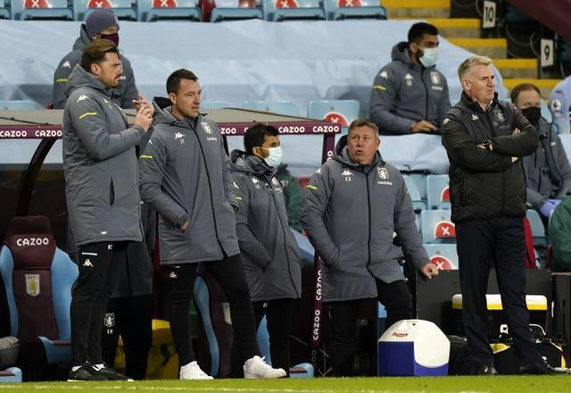 Aston Villa manager Dean Smith (right) and his coaching staff will not present for the third-round clash