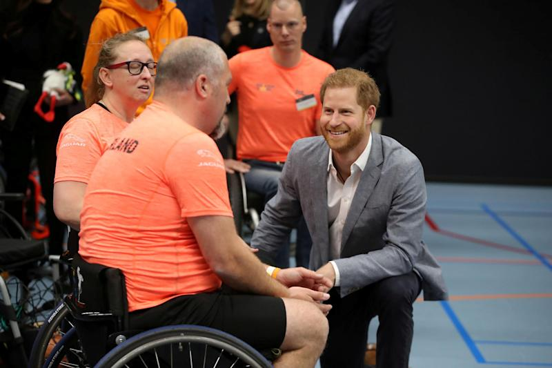 Britain's Prince Harry speaks with athletes during a sports training session at Sportcampus Zuiderpark during a visit to The Hague as part of a programme of events to mark the official launch of of the Invictus Games (REUTERS)