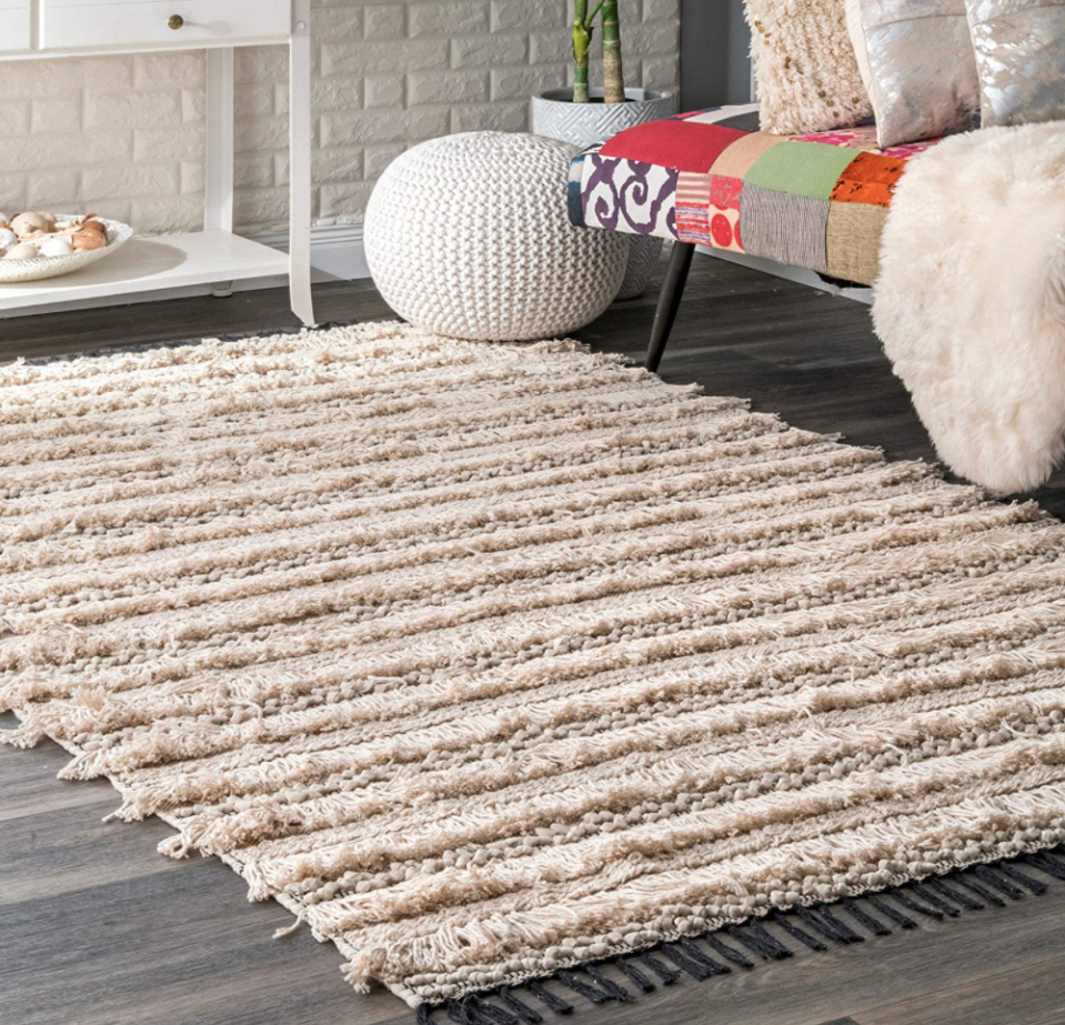 nuLOOM Emerita Tassel Area Rug in Beige (Photo via Amazon)