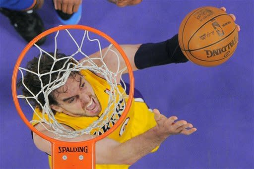 Los Angeles Lakers forward Pau Gasol of Spain puts up a shot during the first half in Game 3 of an NBA basketball playoffs Western Conference semifinal against the Oklahoma City Thunder, Friday, May 18, 2012, in Los Angeles. (AP Photo/Mark J. Terrill)