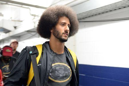 FILE PHOTO: Sep 1, 2016; San Diego, CA, USA; San Francisco 49ers quarterback Colin Kaepernick (7) arrives with teammates before the game against the San Diego Chargers at Qualcomm Stadium. Mandatory Credit: Jake Roth-USA TODAY Sports / Reuters Picture Supplied by Action Images (TAGS: Sport American Football NFL) *** Local Caption *** 2016-09-01T232344Z_1972036663_NOCID_RTRMADP_3_NFL-PRESEASON-SAN-FRANCISCO-49ERS-AT-SAN-DIEGO-CHARGERS.JPG