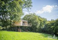 """<p><strong>Sleeps:</strong> 2</p><p>Hidden away in the glorious Ceredigion countryside, this <a href=""""https://go.redirectingat.com?id=127X1599956&url=https%3A%2F%2Fwww.qualityunearthed.co.uk%2Fglamping%2Fwales%2Fcardigan-bay%2Ftreehouses%2Ftyr-onnen-treehouse&sref=https%3A%2F%2Fwww.housebeautiful.com%2Fuk%2Flifestyle%2Fproperty%2Fg33931209%2Ftreehouse-holidays%2F"""" rel=""""nofollow noopener"""" target=""""_blank"""" data-ylk=""""slk:magical treehouse stay"""" class=""""link rapid-noclick-resp"""">magical treehouse stay</a> offers plenty of seclusion for romantic getaways. Listen to nothing but the sound of a brook babbling through the bottom of the garden and the choir of birds singing in the trees while you indulge in the views of the surrounding hills. The off-grid treehouse is equipped with a gas-powered oven, wood burning stove and hot running water.</p><p>Treehouse holidays cost from £485 for three nights from Quality Unearthed</p><p><a class=""""link rapid-noclick-resp"""" href=""""https://go.redirectingat.com?id=127X1599956&url=https%3A%2F%2Fwww.qualityunearthed.co.uk%2Fglamping%2Fwales%2Fcardigan-bay%2Ftreehouses%2Ftyr-onnen-treehouse&sref=https%3A%2F%2Fwww.housebeautiful.com%2Fuk%2Flifestyle%2Fproperty%2Fg33931209%2Ftreehouse-holidays%2F"""" rel=""""nofollow noopener"""" target=""""_blank"""" data-ylk=""""slk:SEE INSIDE"""">SEE INSIDE</a></p>"""