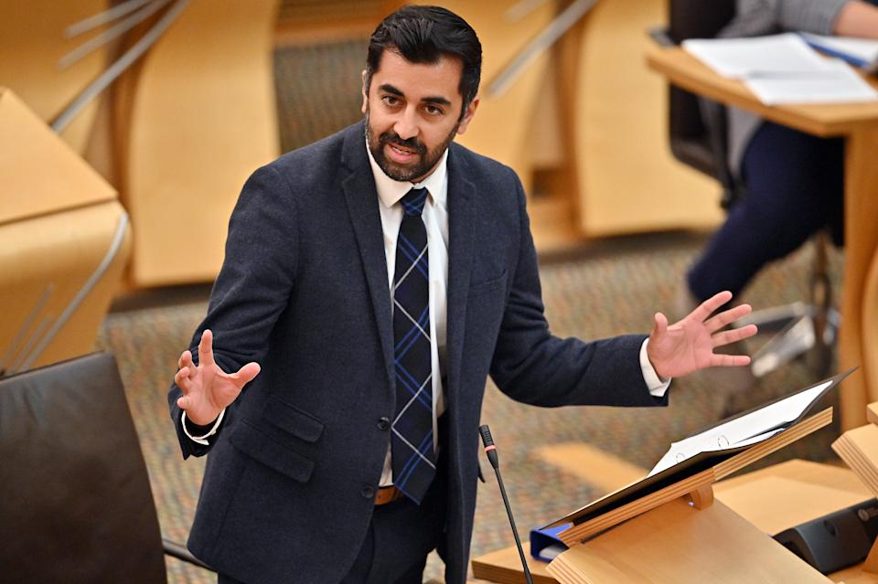 EDINBURGH, SCOTLAND - SEPTEMBER 14: Humza Yousaf Cabinet Secretary for Health and Social Care speaks in the chamber prior to Scotland's First Minister and leader of the Scottish National party, Nicola Sturgeon, delivering her coronavirus update in the Scottish Parliament Building on September 14, 2021 in Edinburgh, Scotland. Sturgeon's address comes after yesterday's announcement from top health officials in the four U.K. nations that the Covid-19 vaccine should be given to 12 to 15-year-olds. (Photo by Jeff J Mitchell - Pool/Getty Images)