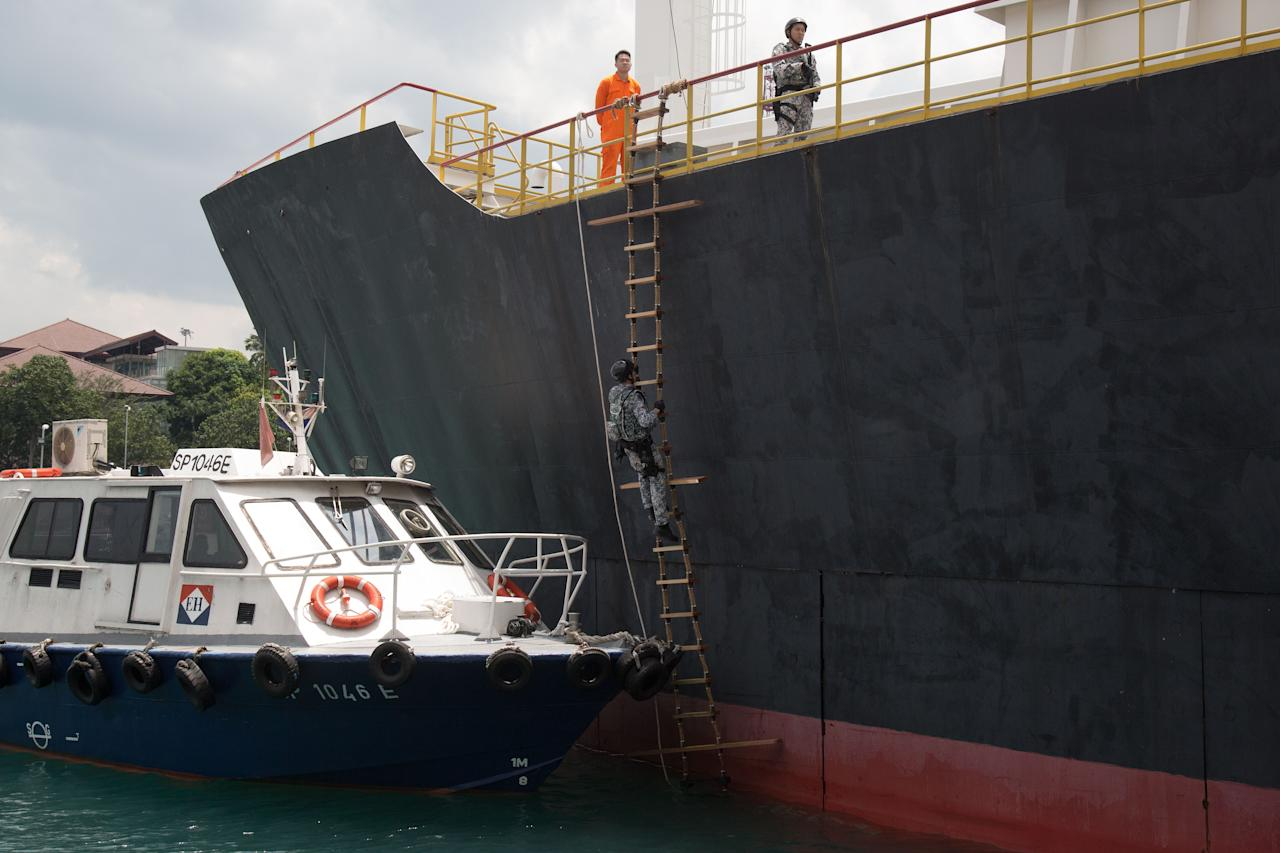 <p>ASSeT troops showing how they board vessels while out at sea. Troops have to perform this task while carrying some 25kg of gear. (PHOTO: Yahoo News Singapore / Dhany Osman) </p>