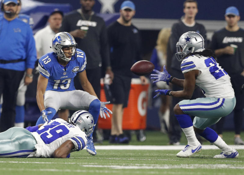 Dallas Cowboys strong safety J.J. Wilcox intercepts a pass from the Detroit Lions' Matthew Stafford during a 2016 game. (AP Photo/Brandon Wade)