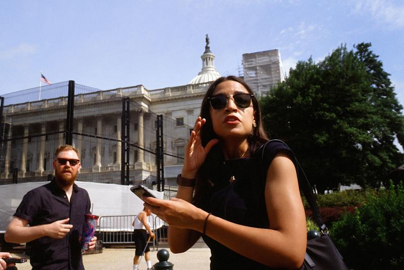 """Riley Roberts, left, 29, walks Ocasio-Cortez to work a few times a week from their apartment near the Capitol. Of security concerns that come with the intense scrutiny Ocasio-Cortez is under, Roberts says, """"I think it's worth it. I think it's unfortunate that this comes with it."""""""