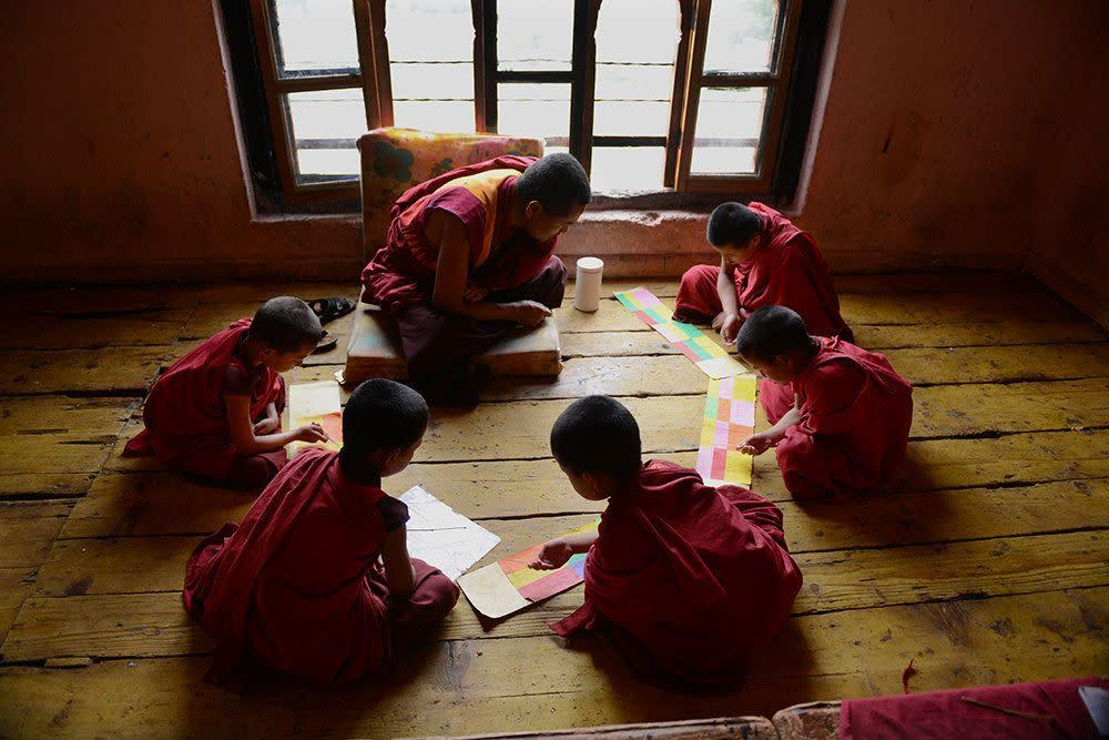 Tandi Dorji sits in a group with other young monks repeating holy scriptures at a monastery in Thimphu on June 4, 2013.
