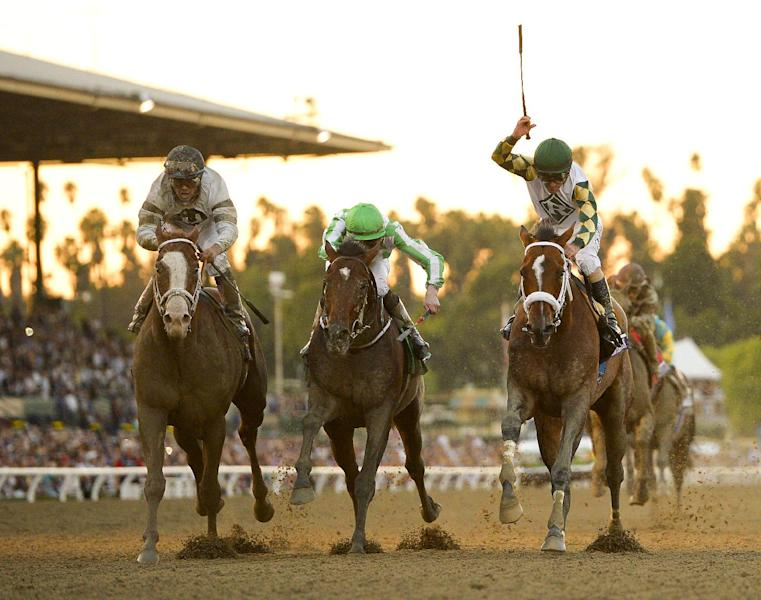 Jockey Gary Stevens, right, rides Mucho Macho Man to victory in the Breeders' Cup Classic horse race ahead of Will Take Charge, left, and Declaration of War at Santa Anita Park Saturday, Nov. 2, 2013, in Arcadia, Calif. (AP Photo/Mark J. Terrill)