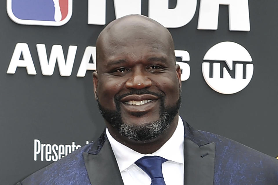 "FILE - This June 24, 2019, file photo shows Shaquille O'Neal at the NBA Awards in Santa Monica, Calif. A woman whose car was left stranded along a Florida interstate when her tire blew out got a little unexpected help from former NBA star Shaquille O'Neal, sheriff's officials say. O'Neal, who lives in the Orlando area, was traveling on Interstate 75 near Gainesville on Monday, July 13, 2020, when he saw the woman pull onto the side of the road, the Alachua County Sheriff's Office said on a Facebook post. He stayed with the woman until deputies arrived at the scene. ""He fist-bumped Deputies Purington and Dillon before going on his way,"" the sheriff's office wrote on Facebook. (Photo by Richard Shotwell/Invision/AP, File)"