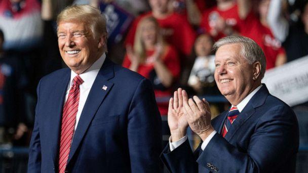 PHOTO: President Donald Trump smiles as he stands alongside Senator Lindsey Graham during a Keep America Great campaign rally in North Charleston, South Carolina, Feb. 28, 2020. (Saul Loeb/AFP/Getty Images)