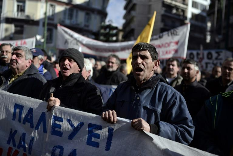 Greek farmers chant slogans as they protest in central Athens on February 14, 2017