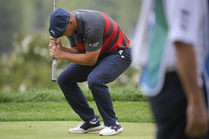 Bryson DeChambeau reacts after missing his putt on the ninth green during the final round of the BMW Championship golf tournament, Sunday, Aug. 29, 2021, at Caves Valley Golf Club in Owings Mills, Md. (AP Photo/Nick Wass)