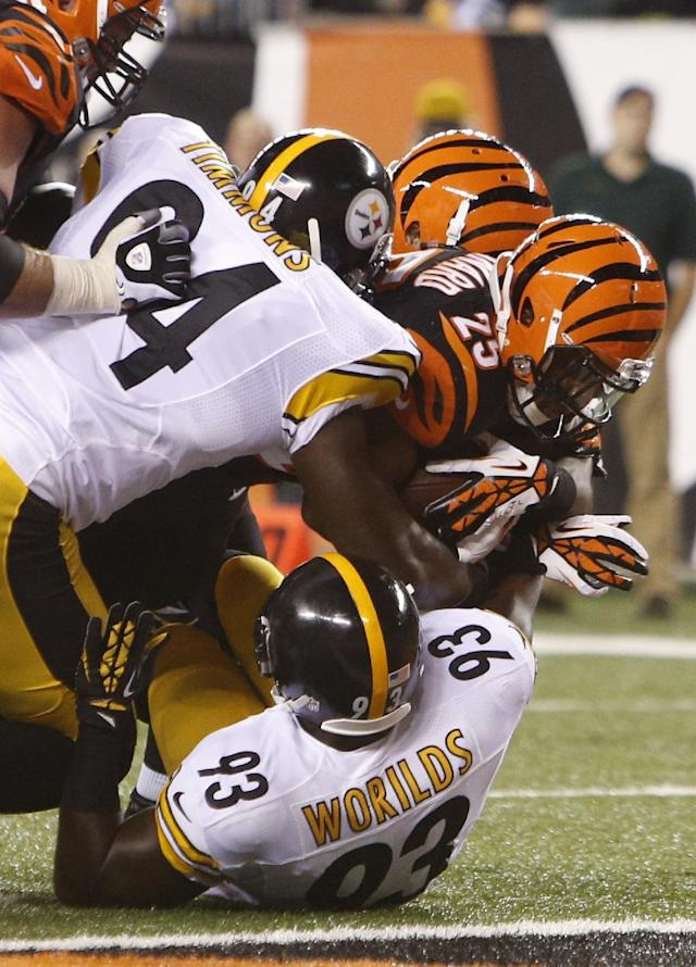 Cincinnati Bengals running back Giovani Bernard (25) scores a touchdown on a seven yard run against Pittsburgh Steelers inside linebacker Lawrence Timmons (94) and outside linebacker Jason Worilds (93) in the first half of an NFL football game, Monday, Sept. 16, 2013, in Cincinnati. (AP Photo/David Kohl)