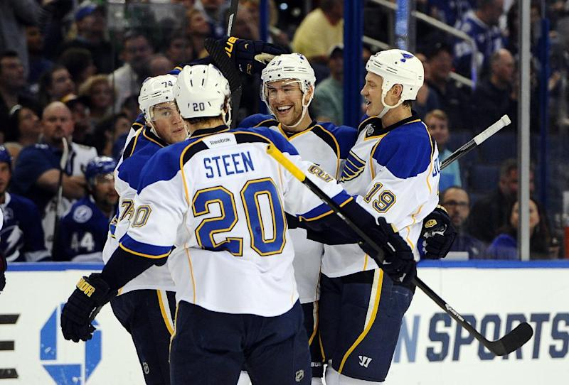 St. Louis Blues defenseman Alex Pietrangelo, third from left, celebrates his goal with teammates center T.J. Oshie, left, left wing Alexander Steen (20) and defenseman Jay Bouwmeester (19) during the first period of an NHL hockey game Saturday, Nov. 2, 2013, in Tampa, Fla. (AP Photo/Brian Blanco)