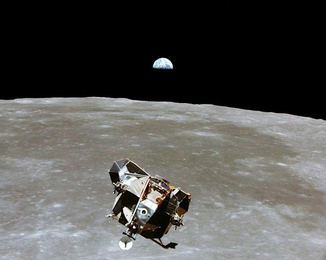 The Apollo 11 Lunar Module ascent stage, with astronauts Neil A. Armstrong and Edwin E. Aldrin Jr. aboard, is photographed from the Command and Service Modules in lunar orbit in this July, 1969 file handout photo.