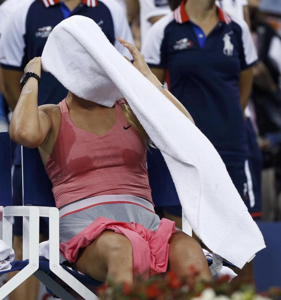Victoria Azarenka of Belarus sits with a towel over her face after being defeated by Serena Williams of the U.S. in their women's singles final match at the U.S. Open tennis championships in New York September 8, 2013. REUTERS/Adam Hunger (UNITED STATES - Tags: SPORT TENNIS)